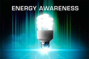 Technology background with energy efficient lightbulb in the forefront.